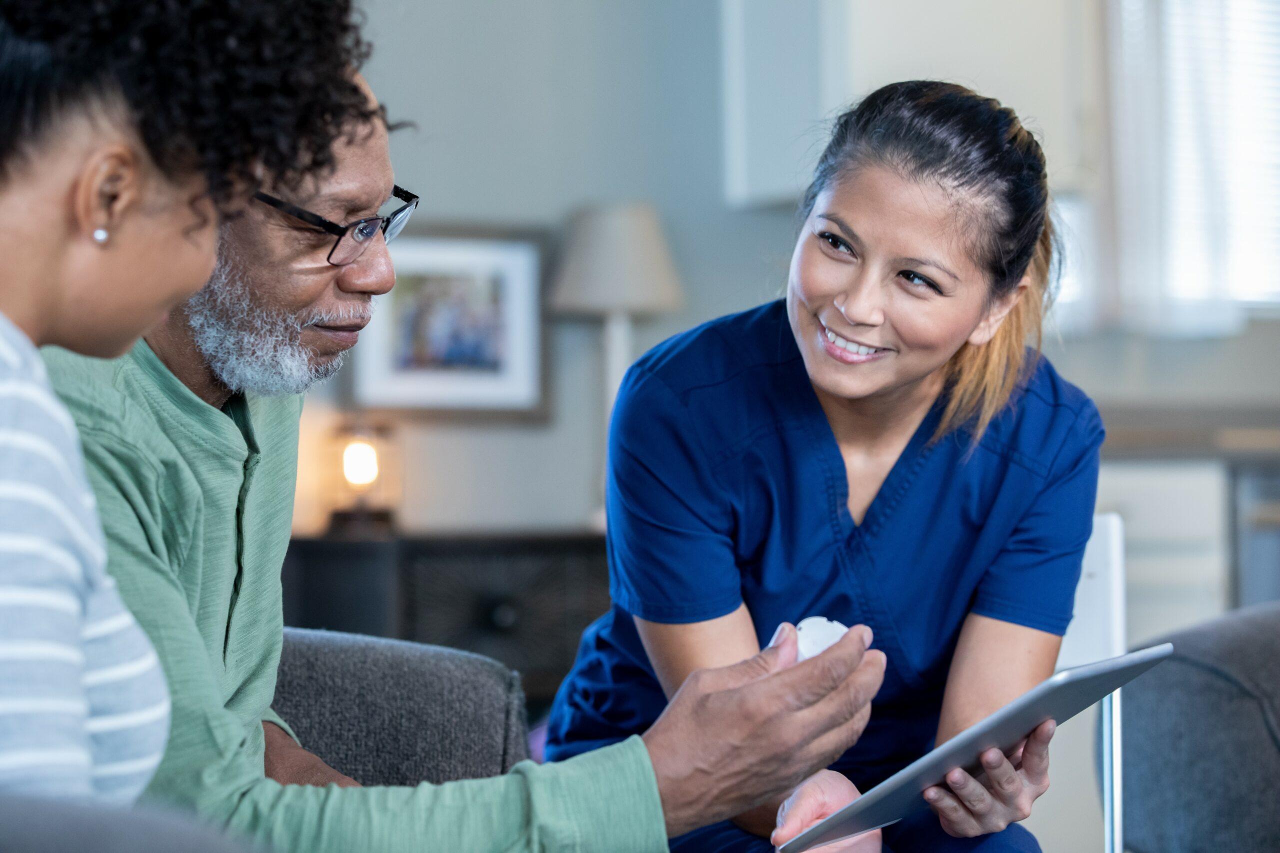 Healthcare nurse explaining medication to man